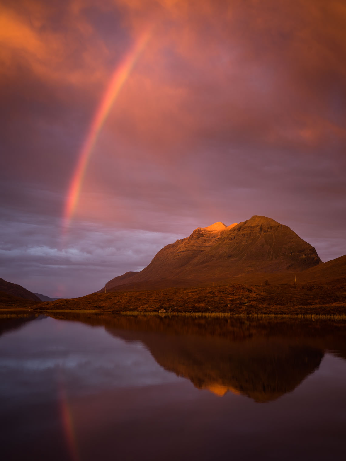 A intense sunrise and rainbow in Glen Torridon
